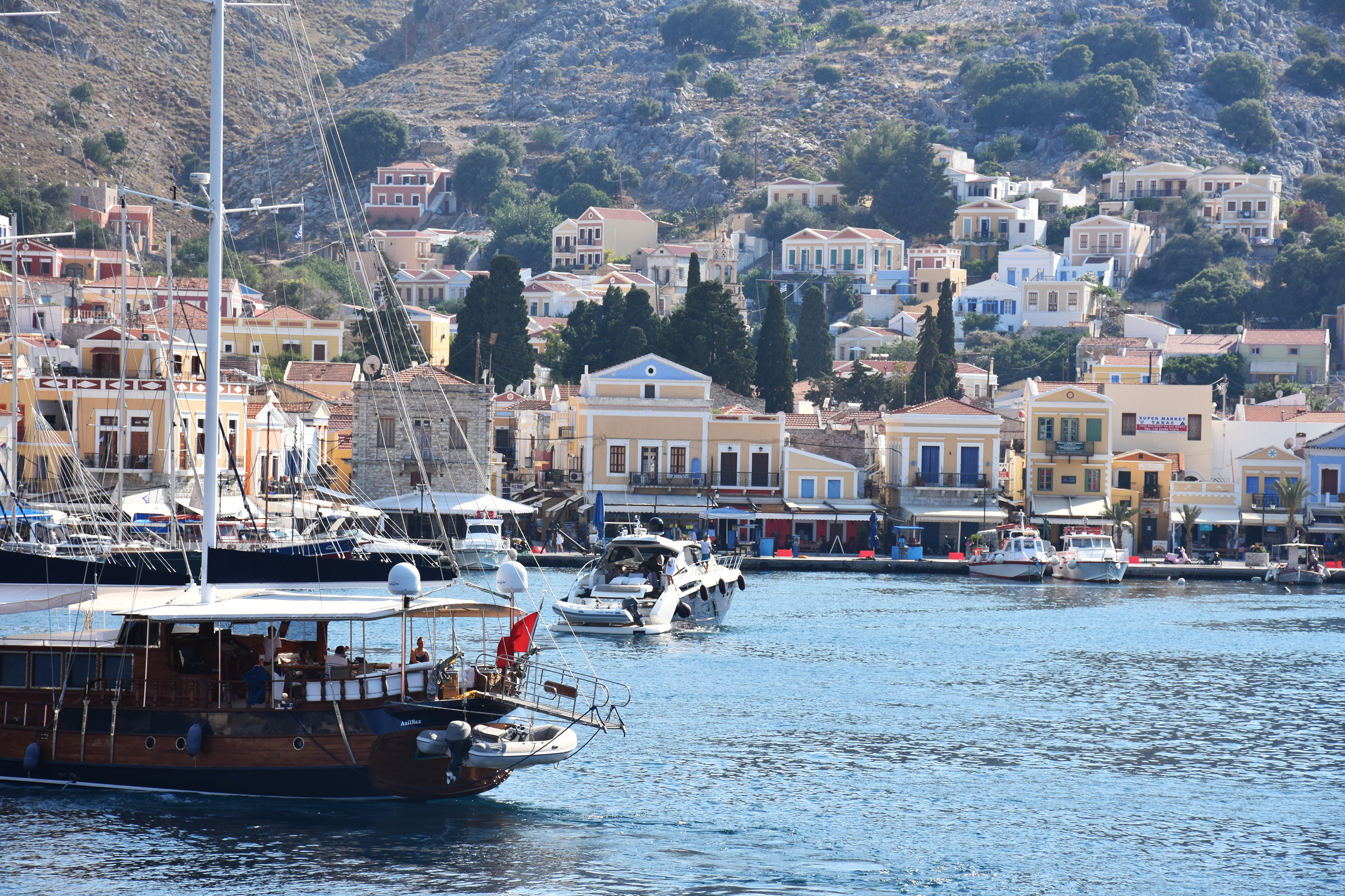 luxurious yachts in front of Symi's Greece traditional port