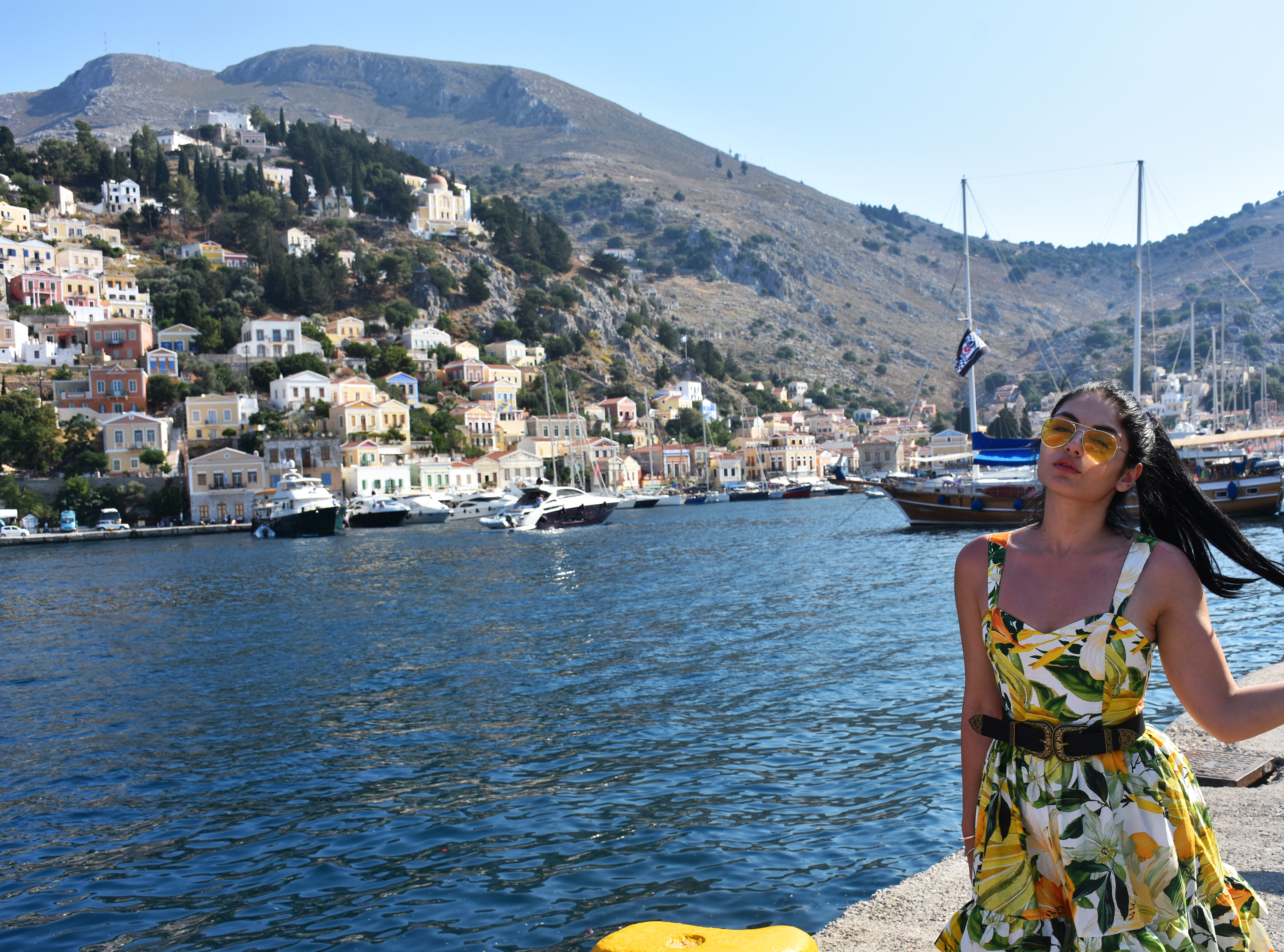 fashion blogger in front of Simis , Greece port wearing floral dress , double buckle next and gucci mules