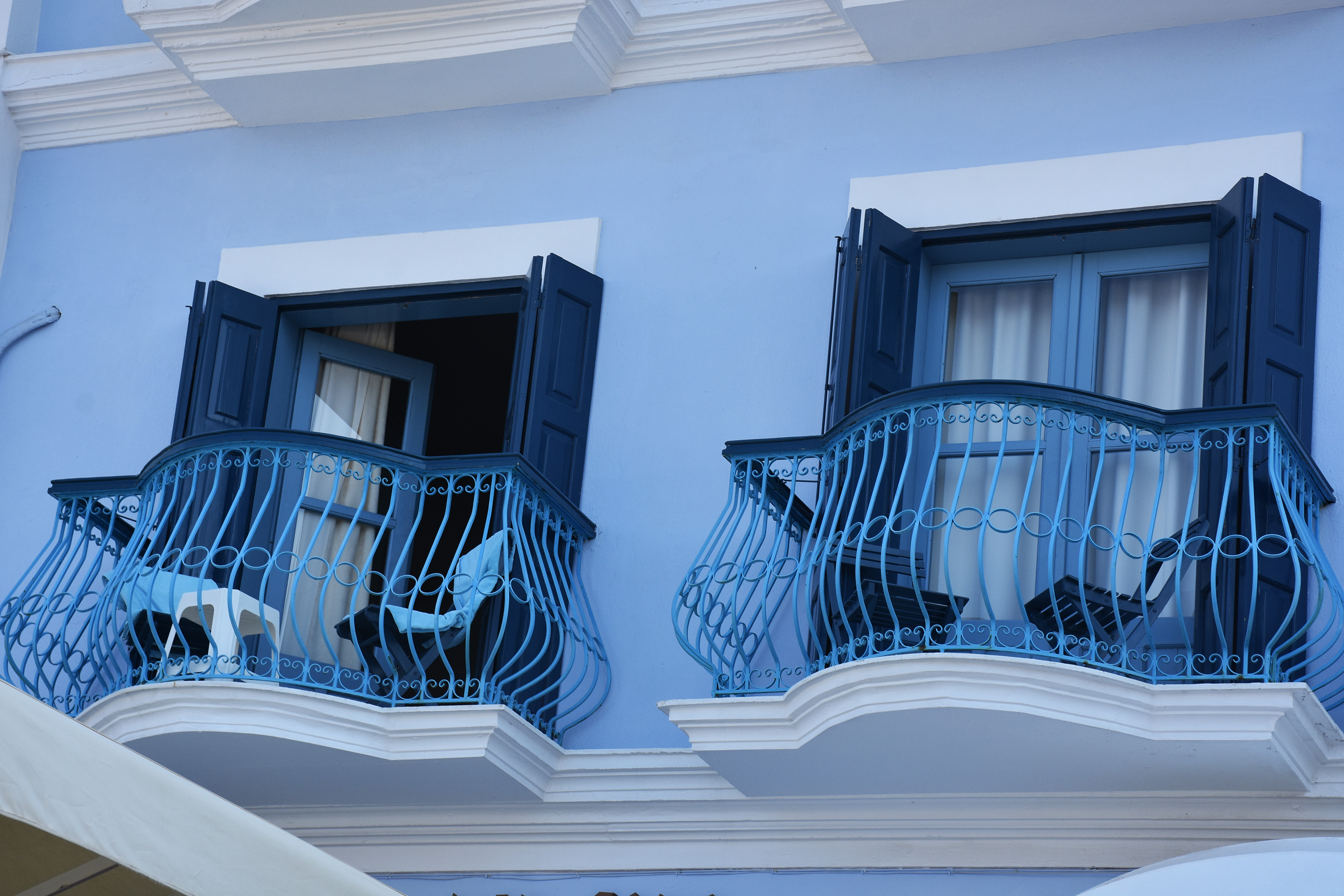 traditional blue house in Simi , Greece